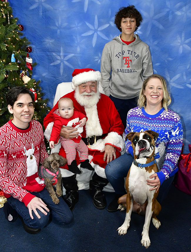 Mike and his family with Santa Claus.